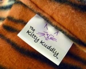 Kitty Kuddly-label