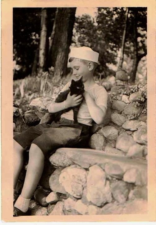 vintage photograp ofh boy and black cat