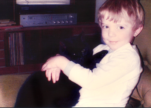 Chris Poole and his first black cat