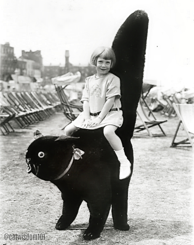 black_cat_chair_girl_vintage 100 Years of Kids Who Love Black Cats