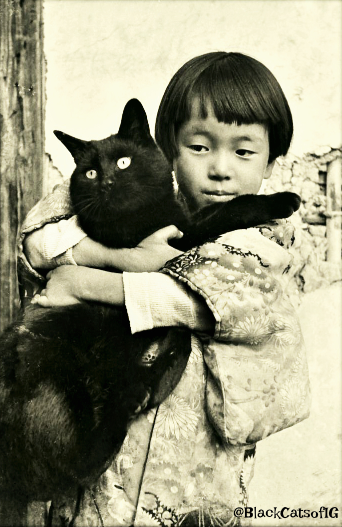 kids and black cats
